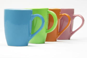 Colourful mugs in a row