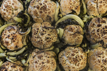 Twelve whole roasted cauliflowers shot from above