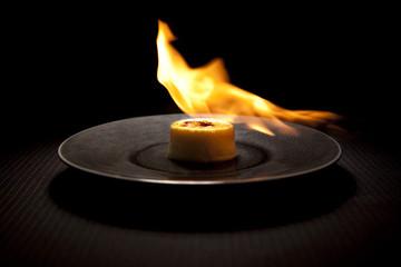 Flamed creme brûlée on plate