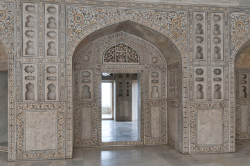 India: Agra Red Fort, a Unesco World Heritage site. Decorated marble walls and doors.