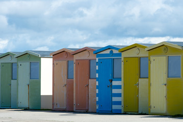 Colourful beach hits on the promenade at Seaford in East Sussex.