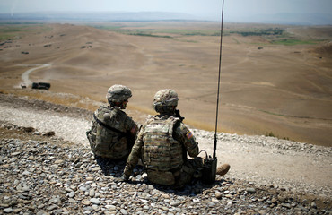 U.S. servicemen watch a drill during NATO-led joint military exercises Noble Partner 2017 at Vaziani Training Area outside Tbilisi