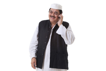 Smiling politician talking on cell phone