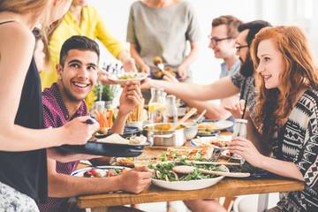 Smiling people enjoy fresh dinner