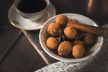 Chocolate truffle and coffee on the wooden table horizontal