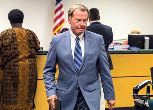 Golfer Tiger Woods' attorney, Douglas Duncan, leaves North Palm Beach County courthouse after filing paperwork in Woods' DUI case, in Palm Beach