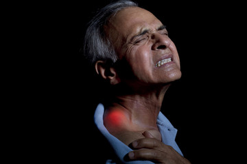 Close-up of an elderly man suffering from shoulder pain