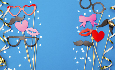 Party background with funny props on a blue background. Wedding, christmas, new year party photobooth.
