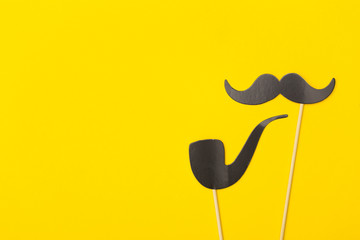 Photobooth props on a yellow background. fathers day