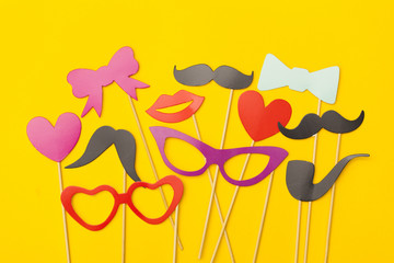 Party props on a yellow background. Birthday, wedding party celebration