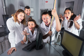 Group of young people having fun in escape room