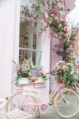 Photography of pink bicycle near restaurant with amazing interior
