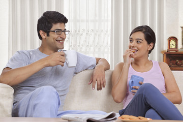 Young couple having coffee together at home
