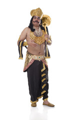 Man dressed as Raavan holding a mace