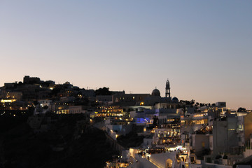 Glowing City Sky Line at Dusk Near Night Time in Greek Island of Santorini