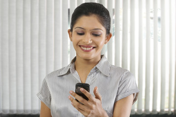 Businesswoman reading a message on a mobile phone