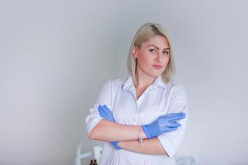 Beautiful female doctor preparing Phillery syringe