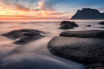 Scenic sunset with smooth water at summer night in Lofoten, Norway