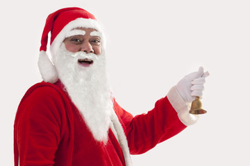 Close up portrait of smiling Santa Claus holding bell against white background