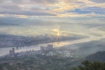 Aerial panorama of foggy Taipei City at dawn, with a bird's eye view of Tamsui River flowing through Kuandu Plain & downtown area ~ Ethereal scenery of a misty & gloomy morning in Taipei, Taiwan, Asia