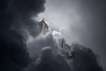 Medieval castle in the middle of the clouds