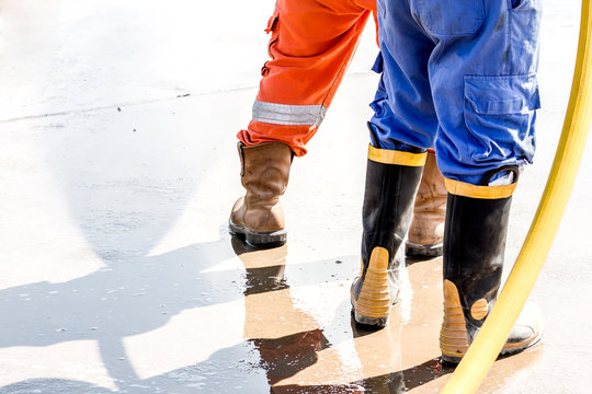close up safety boos.Worker use boot for safety cleaning by water