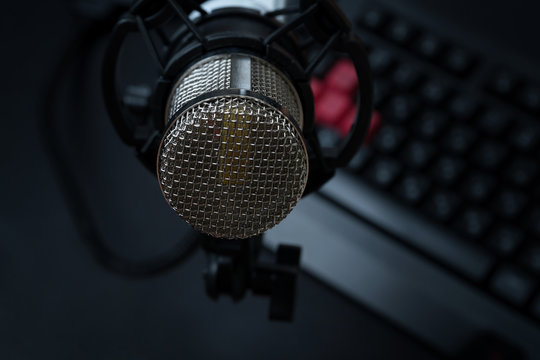 Professional condenser studio microphone over the keyboard