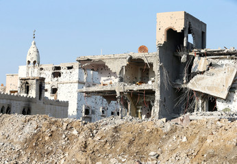 Damaged mosque and remains of buildings are seen following a security campaign against Shi'ite Muslim gunmen in the town of Awamiya