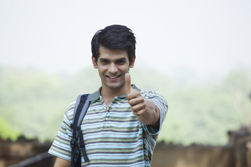 Portrait of a student giving a thumbs up