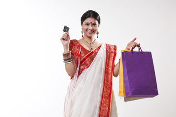 Portrait of a Bengali woman with shopping bags and credit card