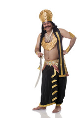 Portrait of a man dressed as Raavan with a sword