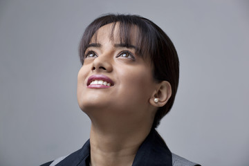 Close-up of happy young businesswoman looking away