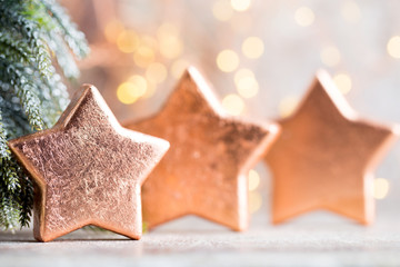 Christmas bronze decoration. Holiday decorations bronze on bokeh background.