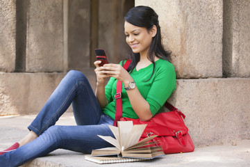 Woman reading an sms on a mobile phone