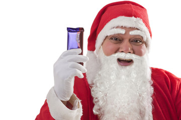 Close-up of cheerful Santa Claus showing chocolate over white background