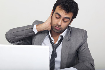 Businessman feeling tired at work