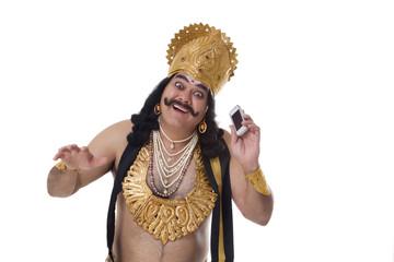 Man dressed as Raavan with a mobile phone