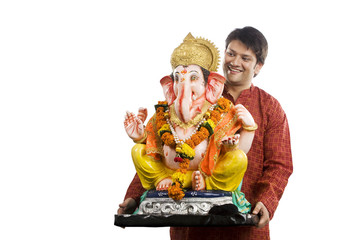 Man carrying a Ganesh idol