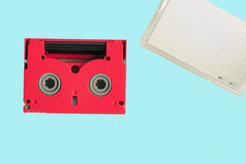 Red 8mm cassette with its box