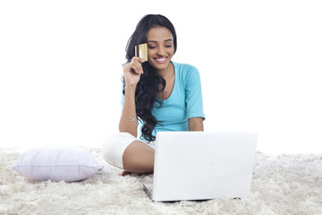 Woman with a credit card and laptop