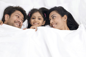Daughter sleeping with her parents