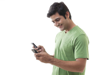 Young man texting over white background