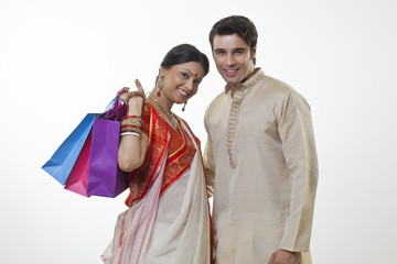 Portrait of a Bengali couple with shopping bags