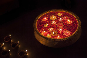 An urn with floating diyas