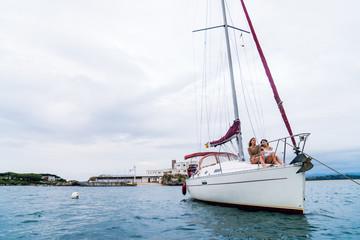 Pretty women posing on sailboat