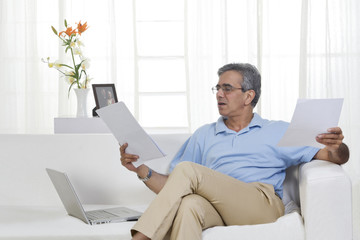 Adult man working on a laptop
