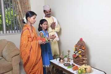 Maharashtrian family praying
