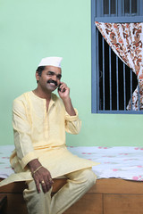 Maharashtrian man talking on a mobile phone