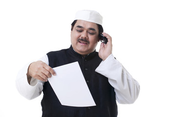 Male politician looking at a document