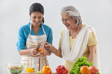 Grandmother and granddaughter working in the kitchen